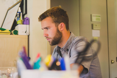bearded guy at work on computer